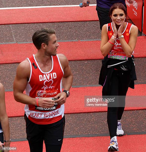 Amy Childs and boyfriend David Peters take part in the Virgin London Marathon on April 21 2013 in London England