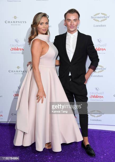 Amy Childs and Harry Derbidge attend the Butterfly Ball 2019 at The Grosvenor House Hotel on June 13 2019 in London England