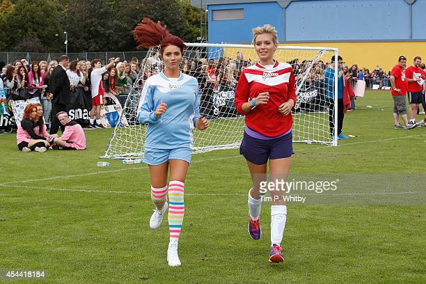 Amy Childs and Rachel Riley during the annual celebrity Soccer Six event at Mile End Stadium on August 31 2014 in London England