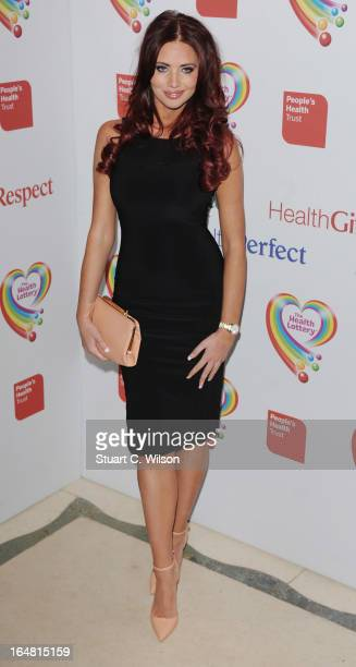 Amy Childs attends a fundraising event in aid of The Health Lottery hosted by Simon Cowell at Claridges Hotel on March 28 2013 in London England