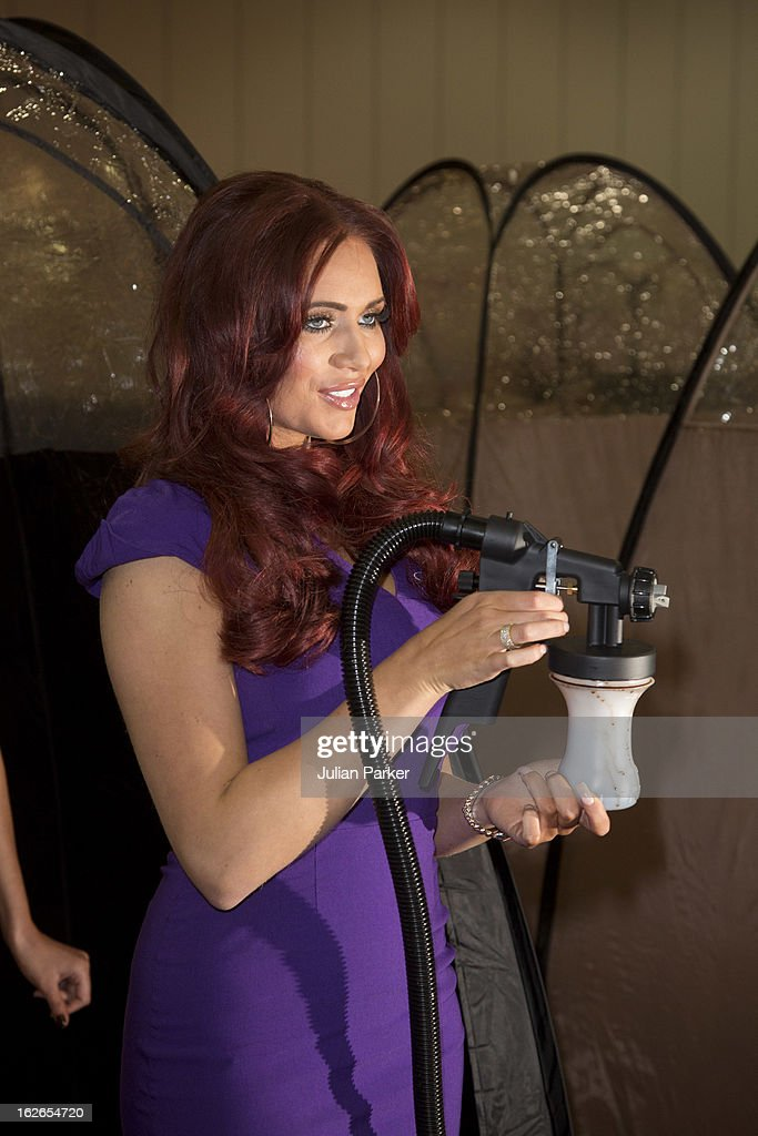Amy Childs attends the Professional Beauty show at ExCel on February 25, 2013 in London, England. The reality TV star took part in a world record attempt with other spray tanners to perform the most simultaneous spray tans in one location, although the Guinness world record was not achieved, the tanners took the UK record.