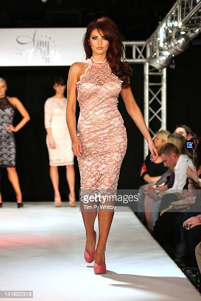 Amy Childs on the runway at the launch of Amy Childs' SS12 Clothing Collection at Gilgamesh on March 19 2012 in London England
