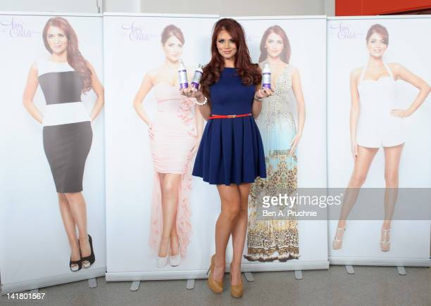 Amy Childs poses with products from her new Tanning range at Tesco Extra on March 24 2012 in Brighton England