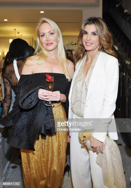 Amy Christiansen SiAhmed and Elisabetta Canalis attend The Tot holiday popup celebration at Laduree at the Grove on December 4 2017 in Los Angeles...
