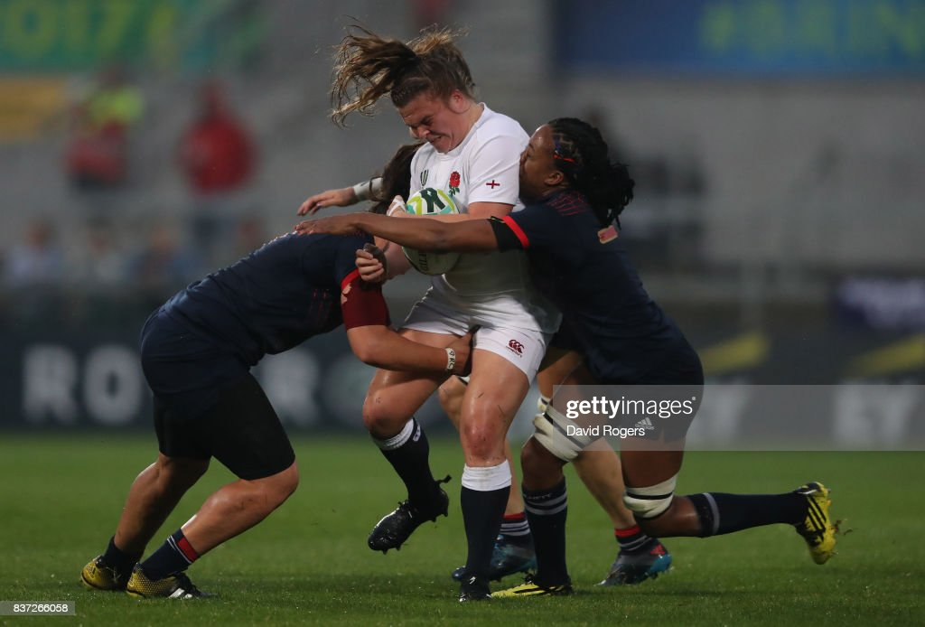 Amy Cokayne of England is tackled by Majorie Mayans #6 and Julie Annery #7 of France during the Women's Rugby World Cup 2017 Semi Final match between England and France at the Kingspan Stadium on August 22, 2017 in Belfast, United Kingdom.