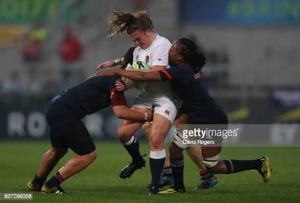 Amy Cokayne of England is tackled by Majorie Mayans and Julie Annery of France during the Women's Rugby World Cup 2017 Semi Final match between...