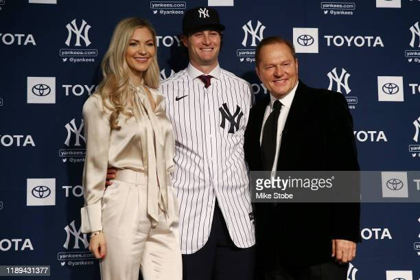 Amy Cole, Gerrit Cole and sports agent Scott Boras pose for a photo at Yankee Stadium during a press conference at Yankee Stadium on December 18,...