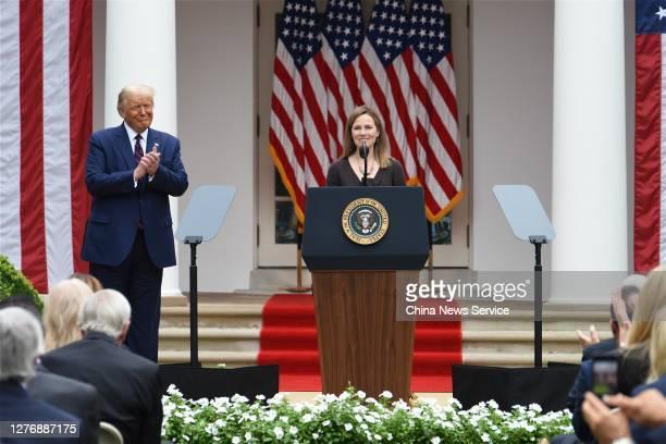 Amy Coney Barrett , U.S. President Donald Trump's nominee for associate justice of the U.S. Supreme Court, speaks as U.S. President Donald Trump...