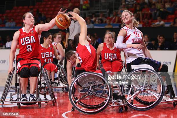 Amy Conroy of Great Britain loses out to Darlene Hunter and Natalie Schneider of USA during the Great Britain versus USA women's basketball match...