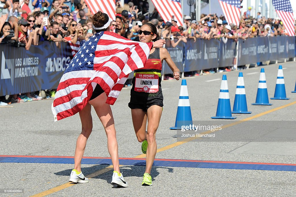 Amy Cragg and Desiree Linden celebrate after finishing first and second in the U.S. Olympic Team Trials Women's Marathon on February 13, 2016 in Los Angeles, California.