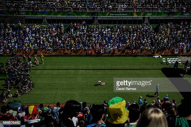 Amy Cragg of the United States falls on her knees after finishing the Women's Marathon on Day 9 of the Rio 2016 Olympic Games at the Sambodromo on...