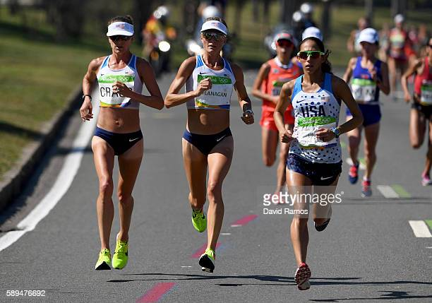 Amy Cragg of the United States, Shalane Flanagan of the United States and Desiree Linden of the United States compete during the Women's Marathon on...