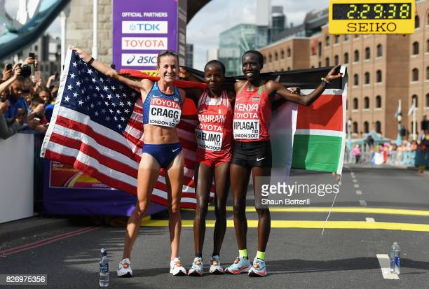 Amy Cragg of the United States third place Rose Chelimo of Bahrain first place and Edna Ngeringwony Kiplagat of Kenya second place celebrate after...