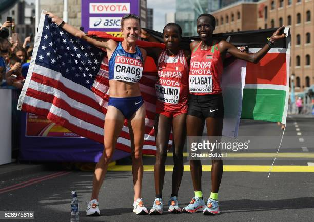 Amy Cragg of the United States, third place, Rose Chelimo of Bahrain, first place, and Edna Ngeringwony Kiplagat of Kenya, second place, celebrate...