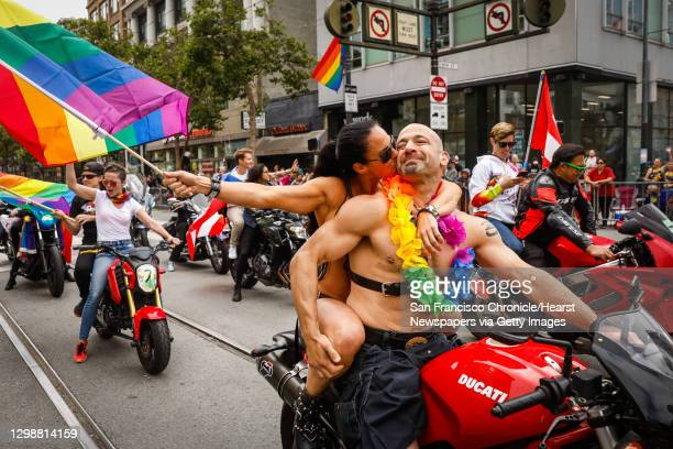 Amy Dabner embraces Adam Schindler at the start of the annual Gay Pride Parade in San Francisco, California, on Sunday, June 30, 2019.