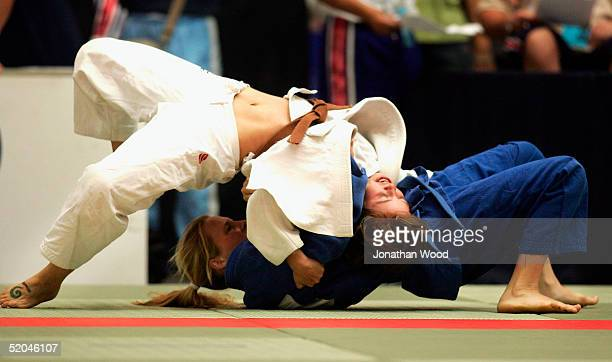 Amy Dillon of Australia in action against Lisa Archibold of New Zealand in the Womens 52kg Judo Competition during day three of the Australian...