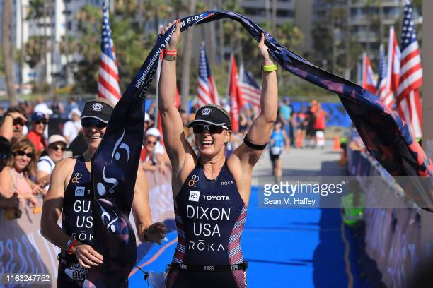 Amy Dixon and guide Kirsten Sass react after finishing first place in the Female PTVI division during the Legacy Triathlon-USA Paratriathlon National...