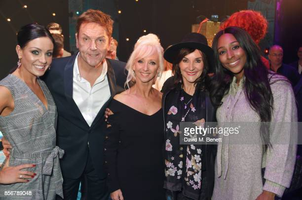 Amy Dowden Brian Conley Debbie McGee Shirley Ballas and Alexandra Burke pose backstage following the cast change press night performance of 'Annie'...