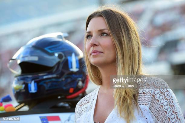 Amy Earnhardt wife of Dale Earnhardt Jr driver of the Nationwide Chevrolet stands on the grid prior to the Monster Energy NASCAR Cup Series 59th...