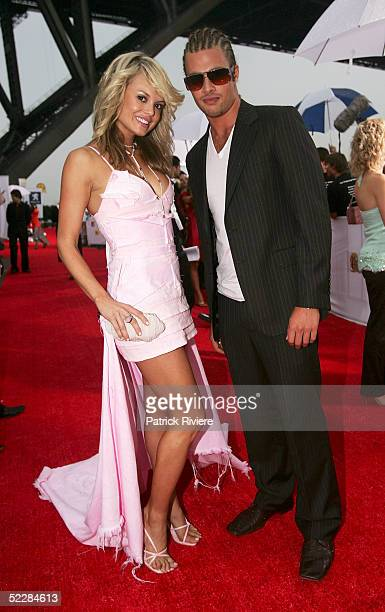 Amy Erbacher and Alex Bruzst arrive at the inaugural MTV Australia Video Music Awards at Luna Park on March 3 2005 in Sydney Australia