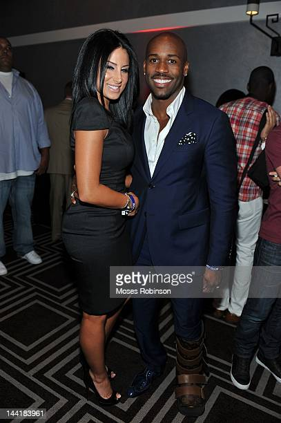 Amy Eslami and fitness trainer Dolvett Quince attend the Welcome to Hotel Noir event at W Hotel Buckhead on May 10 2012 in Atlanta Georgia