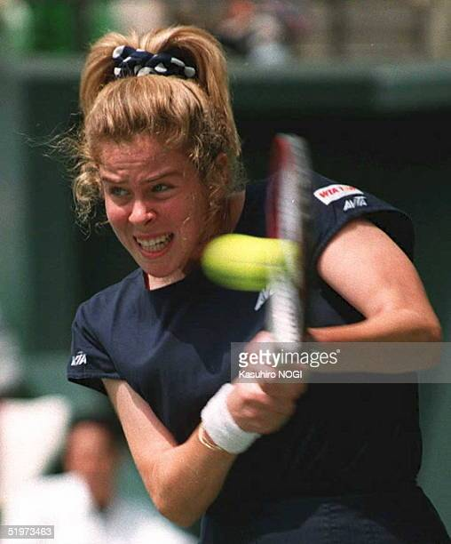 Amy Frazier of the US hits the ball during the women's semifinal match against chineseborn Hong Kong player Tang Min at the Japan Open tennis...