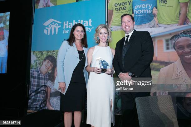 Amy Gardner Sales Director Whirlpool Corporation presents the 2018 Habitat Hero award to AnnMarie Harrison Community Relations Manager and Brandon...