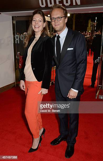 Amy Gilliam and guest attending the closing night Gala screening of 'Fury' during the 58th BFI London Film Festival at Odeon Leicester Square on...