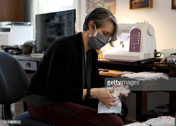 Amy Goring prepares fabric before she sews a mask in her home on March 29 2020 in Maplewood New Jersey Residents of the South Orange Maplewood and...