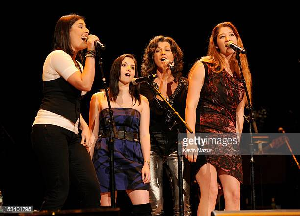 Amy Grant and her daughters perform on stage at the Children's Health Fund 25th Anniversary Concert at Radio City Music Hall on October 4 2012 in New...