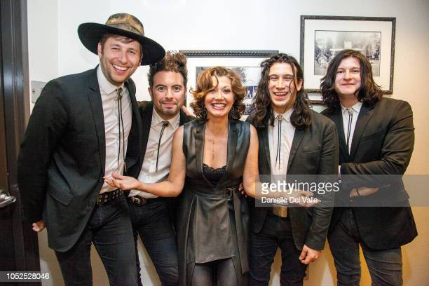 """Amy Grant and The Last Bandoleros take photos backstage during Michael Martin Murphey's """"Austinology Alleys of Austin"""" at Franklin Theater on October..."""