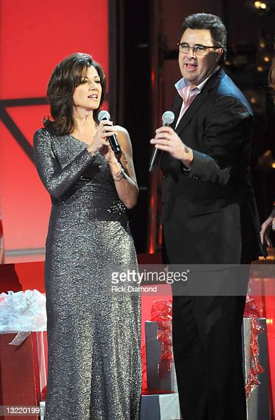 Amy Grant and Vince Gill perform at the 2011 Country Christmas at the Bridgestone Arena on November 10 2011 in Nashville Tennessee