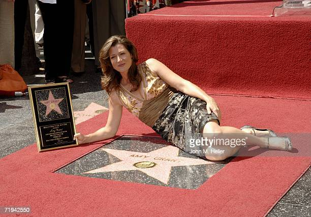 Amy Grant poses next to her newly unveiled Star On The Hollywood Walk Of Fame on September 19 2006 in Hollywood California