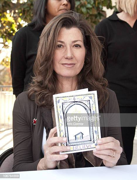Amy Grant signs Christmas cards during the 2010 Holiday Mail for Heroes program launch at the American Red Cross on November 11 2010 in Washington DC