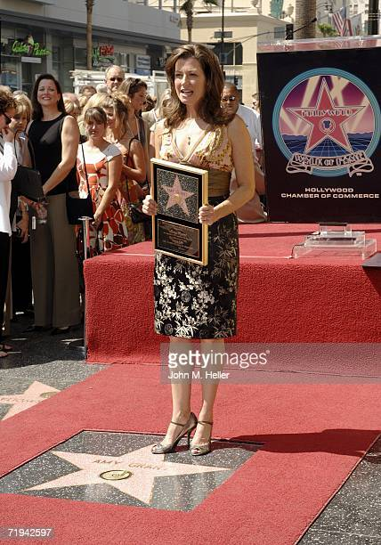 Amy Grant stands on her newly unveiled star on The Hollywood Walk of Fame on September 19 2006 in Hollywood California