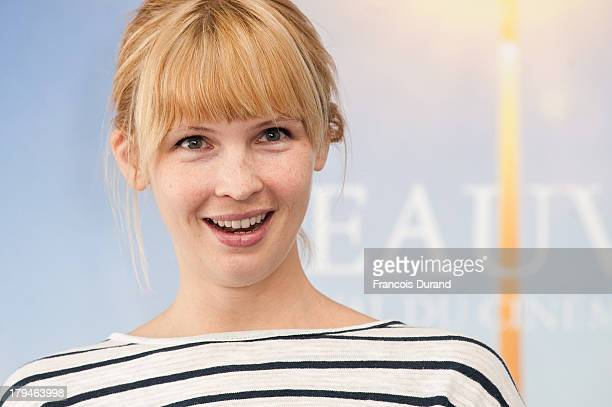 Amy Grantham poses at a photocall for the film 'Lily' during the 39th Deauville Film Festival on September 4 2013 in Deauville France