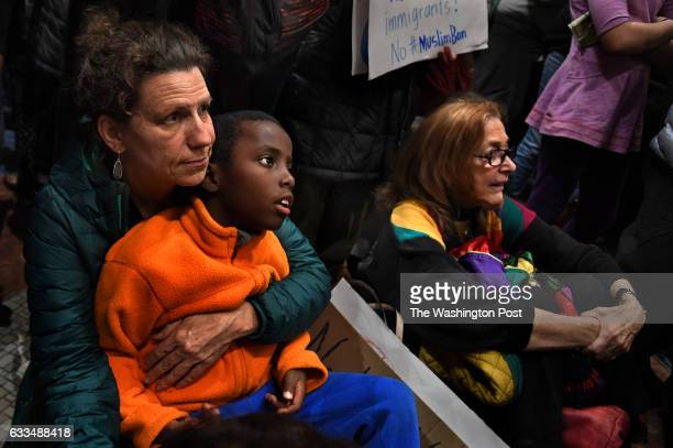 Amy Greene of Arlington Va showed her support for immigrant rights with her son Tadesse Greene She was among scores of folks who turned out for the...