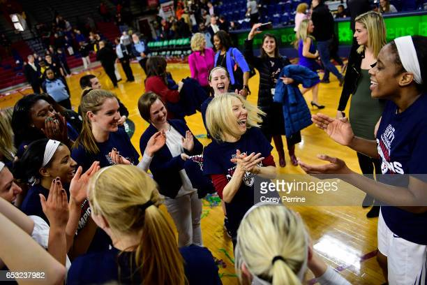 Amy Gutmann President of the University of Pennsylvania celebrates with the Pennsylvania Quakers women's basketball team after the win against the...