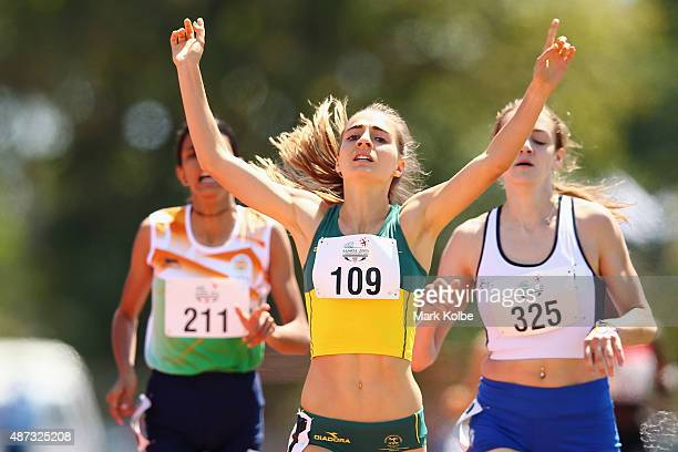 Amy HardingDelooze of Australia celebrates winning the girls 800m final during the athletics competition at the Apia Park Sports Complex on day three...