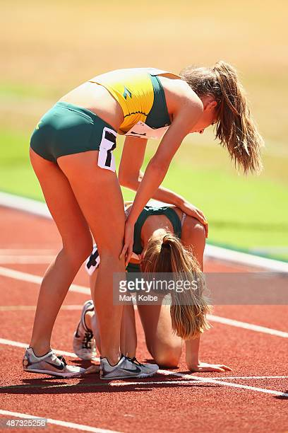 Amy HardingDelooze of Australia comforts Lily HardingDelooze of Australia after the girls 800m final during the athletics competition at the Apia...