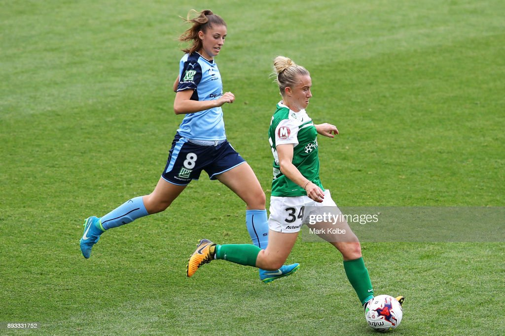 Amy Harrison of Sydney FC and Laura Bassett of Canberra United compete for the ball during the round eight W-League match between Sydney FC and Canberra United at Allianz Stadium on December 15, 2017 in Sydney, Australia.