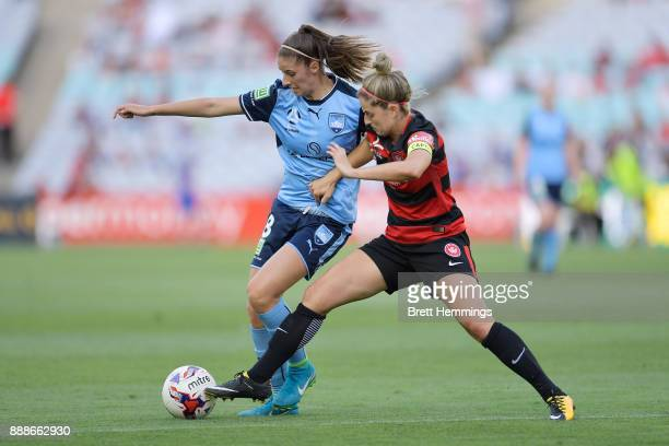 Amy Harrison of Sydney is tackled Ellie Brush of the Wanderers during the W-League match between the Western Sydney Wanderers and Sydney FC at ANZ...