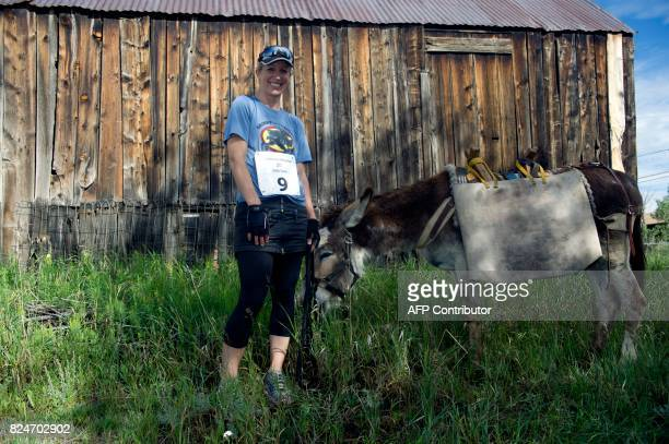 Amy Holtschlag of Conifer Colorado poses for a portrait with her burro Mr Ziffel before running in the Pack Burro Race during the 69th Annual Burro...