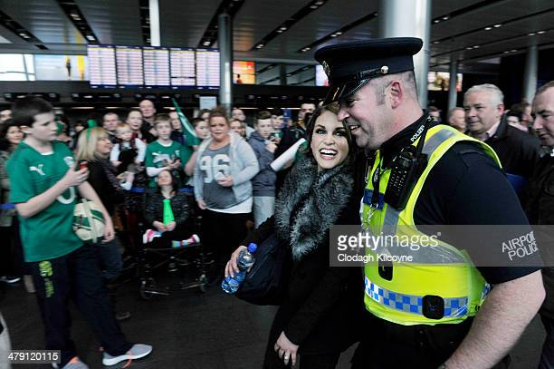 Amy Huberman wife of Brian O'Driscoll receives a police escort out of the airport as she joins the Ireland RBS Six Nations Rugby Championship winners...