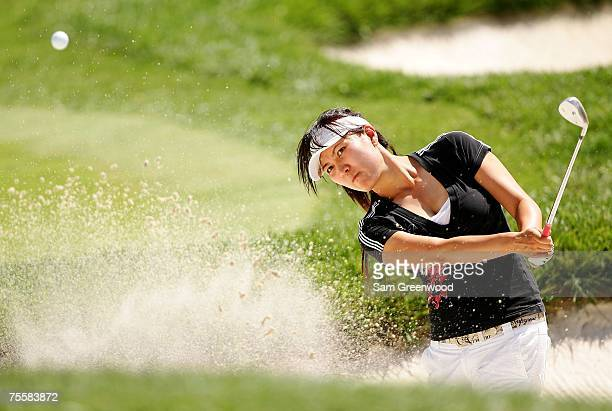 Amy Hung of Taiwan hits a shot from the bunker on the 18th hole during the third round of the HSBC Women's World Match Play at Wykagyl Country Club...