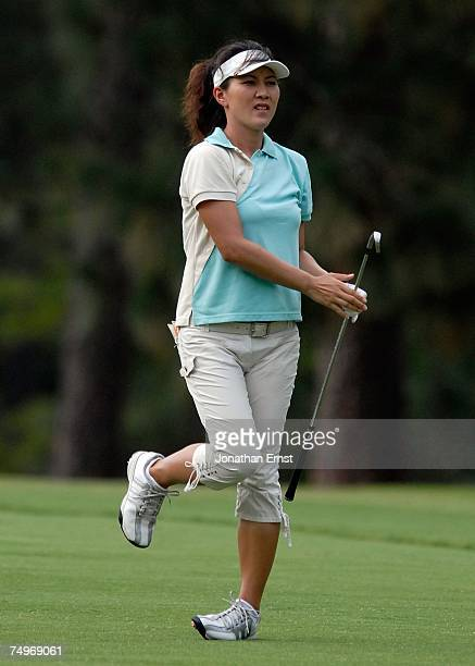 Amy Hung of Taiwan watches her approach shot to the second green during round three of the US Women's Open Championship at Pine Needles Lodge Golf...