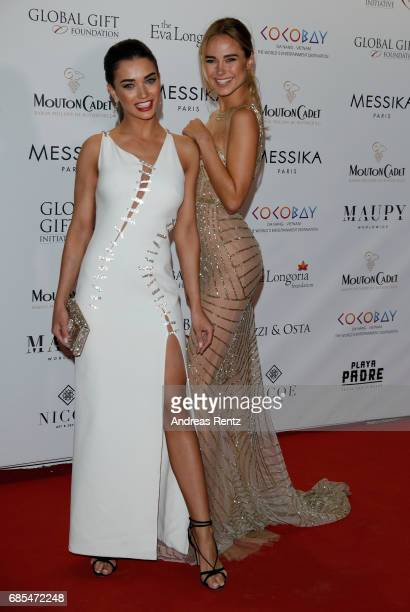 Amy Jackson and Kimberley Garner attend the Eva Longoria Global Gift Gala during the 70th annual Cannes Film Festival at on May 19 2017 in Cannes...