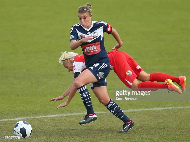 Amy Jackson of Melbourne and Kristy Moore of Adelaide compete for the ball during the round five WLeague match between Melbourne and Adelaide at...