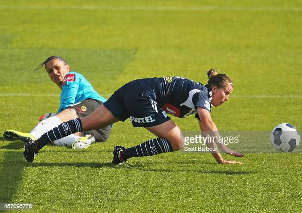 Amy Jackson of Melbourne beats Adelaide goalkeeper Melissa Barbieri to score her third goal during the round five W-League match between Melbourne...
