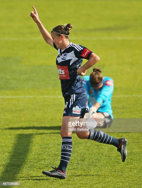 Amy Jackson of Melbourne celebrates after beating Adelaide goalkeeper Melissa Barbieri to score her third goal during the round five W-League match...
